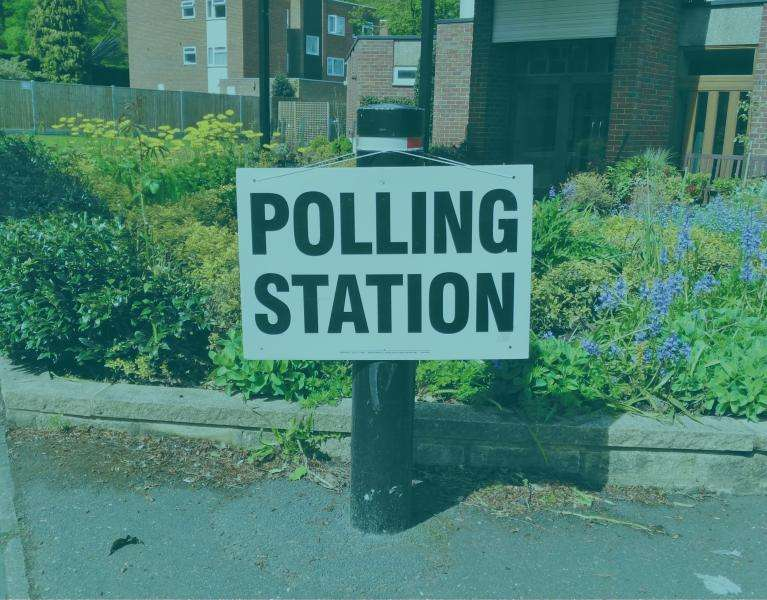 Polling station sign fixed to a post
